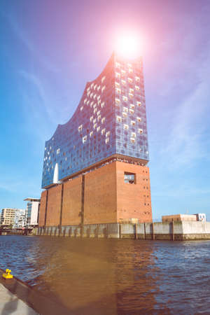 sight seeing: HAMBURG, GERMANY - May 28, 2017: The concert hall Elbphilharmonie with Sunflares above