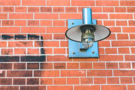 metall lamp: Metall lamp fixed on a brick wall