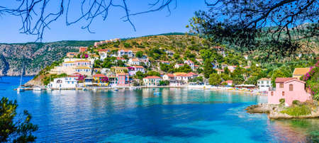 Assos village in beautiful azure cove in Kefalonia, Greece. Banner