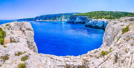 Cliff coastline wiht sand rocks near Alaties Beach, Kefalonia, Ionian islands, Greece Stock Photo