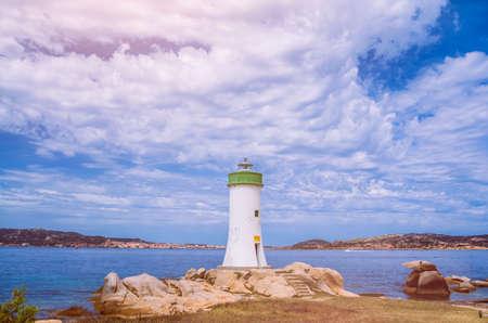 White lighthouse and cloudscape. Sardinia Island, Italy 版權商用圖片