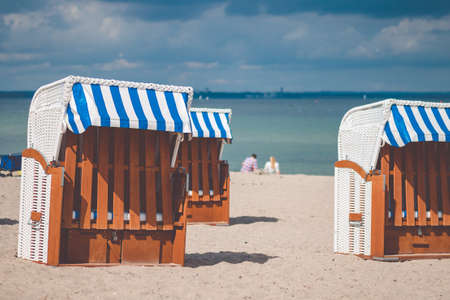Colourful beach roofed chairs in Travemunde, Germany