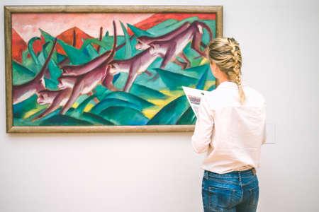 HAMBURG, GERMANY - 9 JULY 2017: Hamburg museum. of art Jung woman admire the painting