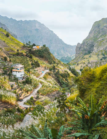 View of dwellings between landscape of vegetation and mountains of the Paul Valley, on the island of Santo Antao, Cape Verde