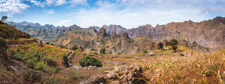 Gorgeous panorama view of the fields of intensive terrace cultivation surrounded by the huge barren mountain peaks, walls and cliffs. Santo Antao Island, Cape Verde Stock Photo