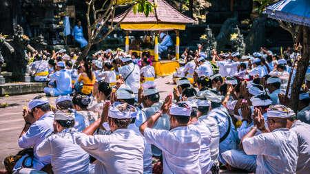 GOA LAWAH, BALI, INDONESIA - November 3, 2016: Balinese praying on ceremony at Pura Goa Lawah temple, Bali, Indonesia Editorial