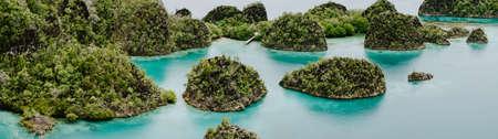 Painemo Islands panoramic shot, Blue Lagoon, Raja Ampat, West Papua, Indonesia
