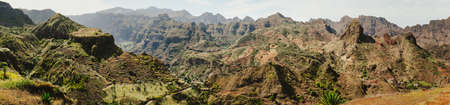 Gorgeous panorama view of huge barren mountain peaks, cliff and canyons of dry arid desert landscape. Ribeira Grande. Santo Antao Island, Cape Verde Stock Photo