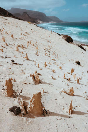 Bizarre sandstone formations in the lunar landscape on the coastline of Sao Vicente Island Cape Verde