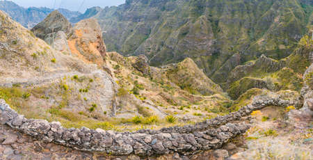 Vertiginous steel trekking trails leads between huge rocks down to the Coculi valley. Santo Antao Island, Cape Verde Stock fotó
