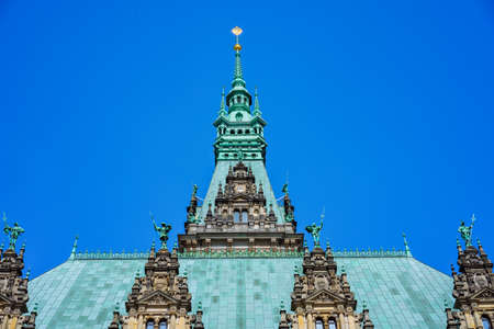 Decorated emerald colored roof and facade of the beautiful famous Rathaus Hamburg town hall in Altstadt quarter, Hamburg, Germany