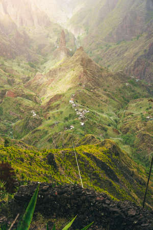 Mountain peaks of Xo-Xo valley in sun light. Local village in the valley. Many agava plants grow on the steep stony slopes. Santa Antao island, Cape Verde Stock Photo
