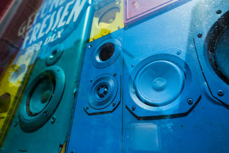 Old colorful sound speakers boxes in shop window vitrine. Concept of retro vintage interior decoration Stock Photo