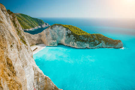 Navagio beach or Shipwreck bay with turquoise water and pebble white beach. Famous landmark location. overhead landscape of Zakynthos island, Greece Stock Photo