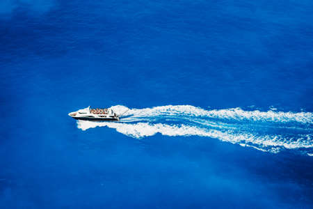 Aerial top view of tourist speed boat sailing in the deep blue sea Stock Photo