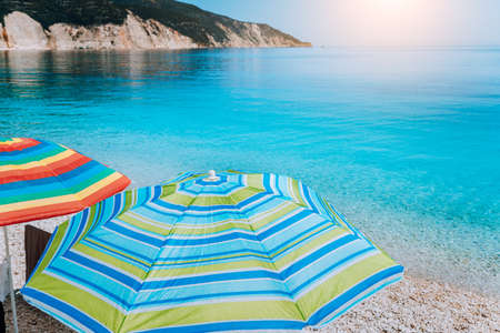 Fteri beach in Kefalonia Island, Greece. One of the most beautiful untouched pebble beach with pure azure emerald sea water surrounded by high white rocky cliffs of Kefalonia Stock Photo
