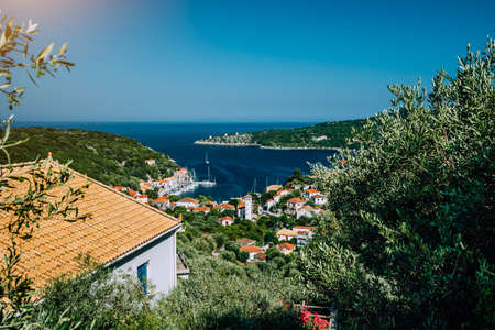 Greece, the island of Ithaca Ithaki. Stunning view of the remote Mediterranean town, olive groves and blue sea bay. Vacation in Greece, summer time Stock Photo