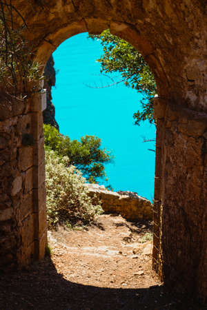 Ruins arch gate entrance of old fortress in Assos on Kefalonia island in Greece