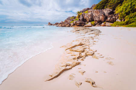 Amazing Granite rocks, white sand and blue clear ocean at Grand Anse, La Digue island, Seychelles. Nature background Stock Photo - 121881562