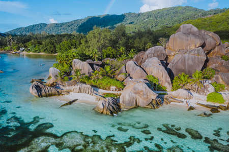 Aerial photo of amazing granite Rocks on beautiful paradise tropical beach Anse Source D Argent at La Digue island, Seychelles. Summer vacation, travel and lifestyle concept