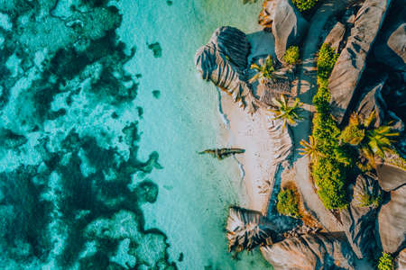 Aerial photo of famous paradiselike tropical beach Anse Source D Argent at La Digue island, Seychelles. Summer vacation, travel and lifestyle concept Banco de Imagens
