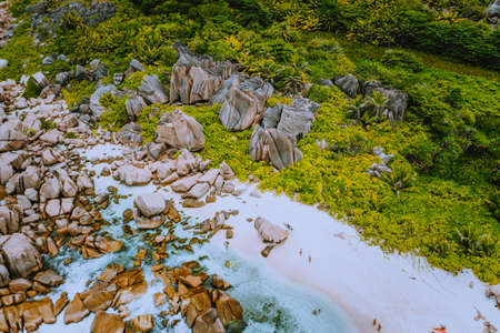 Aerial view of Seychelles tropical Marron beach at La Digue island. White sand beach with turquoise ocean water and granite rocks Stock Photo