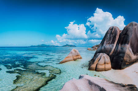Bizarre huge granite rocks boulders at the famoust Anse Source dArgent beach on island La Digue in Seychelles. Exotic paradise scenery concept