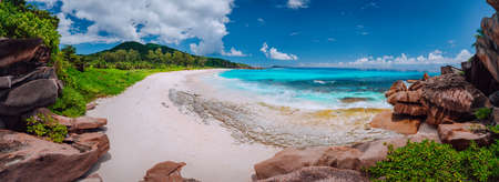 Panoramic view of most spectacular tropical beach Grande Anse on La Digue Island, Seychelles. Vacation holidays relaxing concept Stock Photo