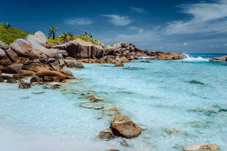 Low tide on paradise beach Anse Cocos on La Digue, Seychelles. Vacation background