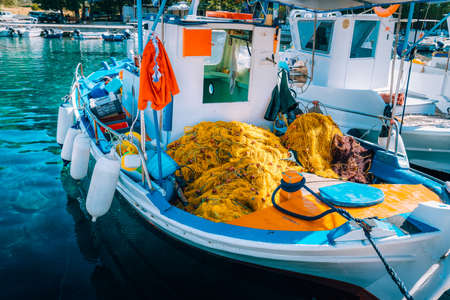 Traditional colorful fishing boat in the sea, Greece. Sunny summer day Stock Photo - 121881524