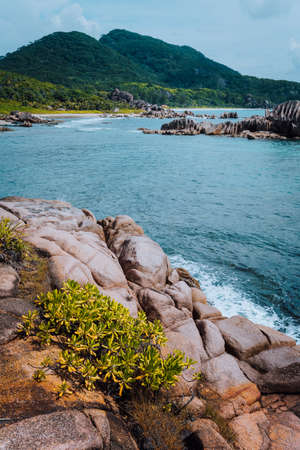 Uniquely natural seascape of La Digue island at Seychelles. Secluded remote beach with granite rocks Stock Photo