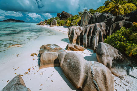 Anse Source dArgent - Paradise beach with bizarre rocks, blue lagoon water on La Digue island in Seychelles