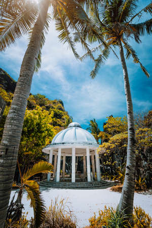 Abandoned Matinloc Shrine between two palm trees at the western coast of Matinloc Island at Palawan, Philippines Stock Photo - 123541215
