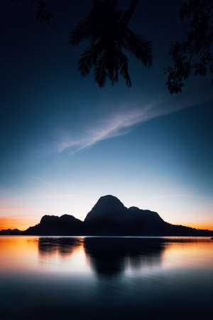 El Nido silhouette of beautiful Cadlao Island in dusk light after sunset in Palawan Island, Philippines Stock Photo - 123541216