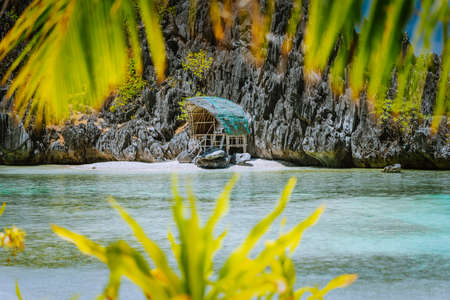 Hidden or Star Beach with sporadic accommodation in pure paradise nature in Matinloc Island in El Nido, Palawan, Philippines. Tour C route and Sightseeing Place