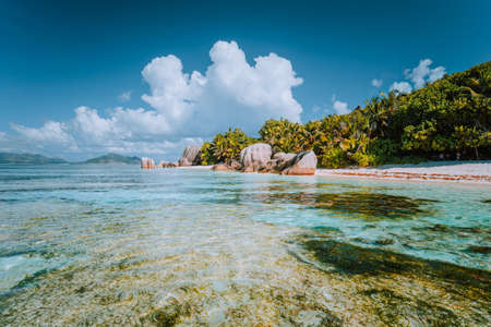 Anse Source dArgent - Paradise beach with bizarre rocks, shallow lagoon water on La Digue island in Seychelles Stock Photo