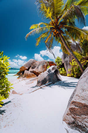 Footpath to tropical beach Anse Source dArgent between granite rocks and palm trees, La Digue Island, Seychelles. Stock Photo