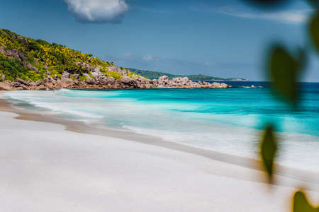 Petite Anse, La Digue in Seychelles. Tropcial, white sand paradise beach with turquise colored water on bright sanny day.