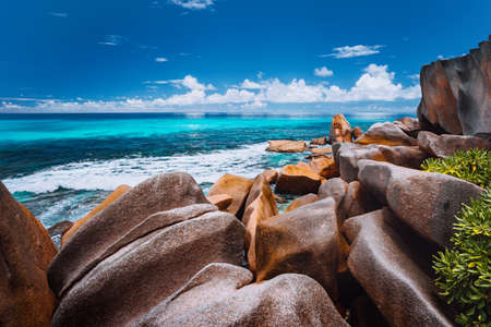 Beautifully shaped granite boulders on Grand Anse beach, La Digue island, Seychelles.