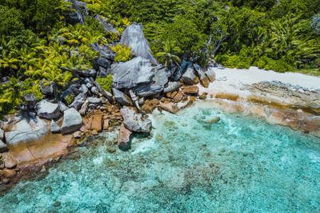 Aerial drone shot of grand L Anse remote tropical beach at La digue, Seychelles Reklamní fotografie