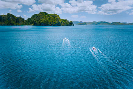 Aerial view of island hopping boats on the way to tour route abound picturesque archipelago. El Nido, Palawan, Philippines Stock Photo
