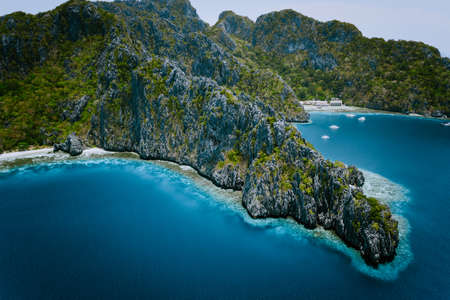 Miniloc Island with limestone cliffs. Aerial drone panoramic picture. Bacuit Archipelago, El Nido, Palawan, Philippines