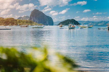 Beautiful tropical scenery. El-Nido, Philippines. Banca boats resting on tranquil early morning at Corong Corong lagoon.
