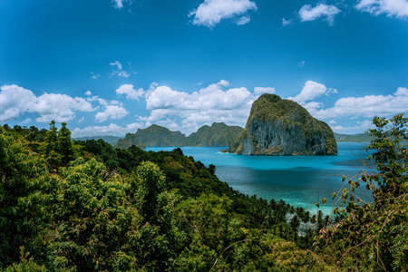 Panoramic aerial view of tropical shoreline on Palawan with epic Pinagbuyutan island on horizon. El Nido-Philippines. Best natural wonder in Southeast Asia Bacuit archipelago