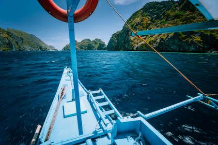 Island hopping Tour C, boat approaching world famous touristic spot locations, travel tour trip explore El Nido, Philippines