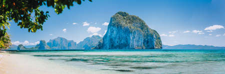 Bay beach and mountains isles panorama in Palawan Philippines Islands view from turquoise shallow sea at sunny day Stok Fotoğraf