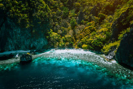 El Nido, Palawan, Philippines, aerial view of banca boat, karst mountain wall pristine sand beach and coral reef, great secret island hopping location Stok Fotoğraf