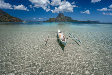 Crystal clear shallow water, low tide, exotic paradise islands, amazing nature of Palawan, Philippines