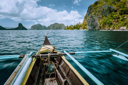 Discover exploring El Nido Nature Reserve in the province of Palawan with fishing boat world famous touristic spot locations, travel tour trip Philippines.