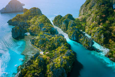 Aerial drone view of Big lagoon and majestic rocks. Discover explore El Nido, Palawan Philippines. stunning attraction, tour trip, island hopping.
